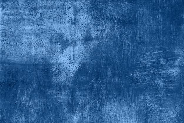 Abstracte donkere zwart-wit grunge textuur met krassen, kopie ruimte. trendy blauwe en rustige kleur. concrete textuur, stenen achtergrond
