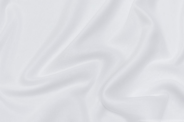 Abstracte en zachte focusgolf van witte of ivoorkleurige stofachtergrond, witte textuur en detail
