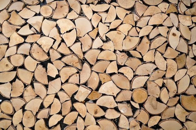Abstracte foto van een stapel van natuurlijke houten logboekenachtergrond