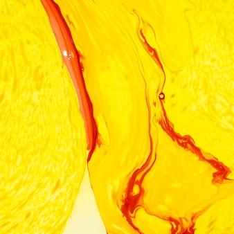 Abstracte gele lagen met rode lijnen