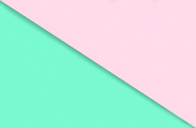 Abstracte geometrische aquarel papier achtergrond in zachte pastel roze en groene trendkleuren met diag...
