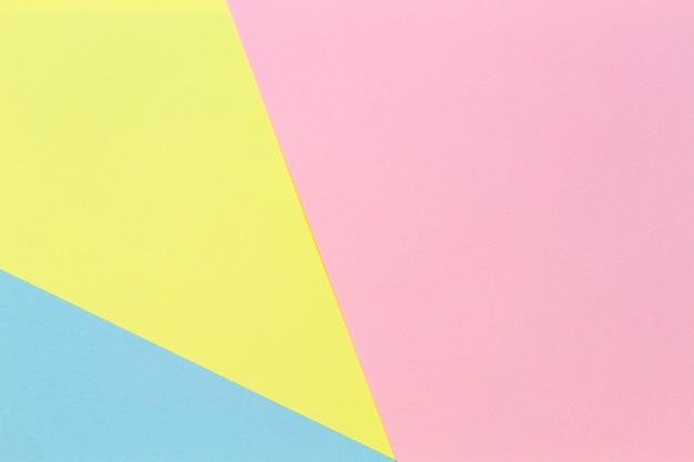 Abstracte geometrische vorm pastel geel roze en blauwe kleur papier achtergrond