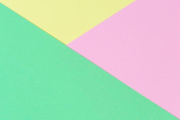 Abstracte geometrische vorm pastel groen roze en gele kleur papier achtergrond