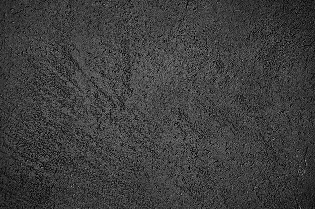 Abstracte getextureerde donkergrijze of zwarte oppervlaktetextuur ruwe achtergrond, cement betonnen vloer of muur Premium Foto