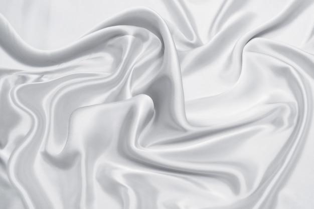 Abstracte gladde witte stof zijde of satijn textuur