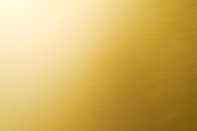 Abstracte glanzende gouden textuurachtergrond.