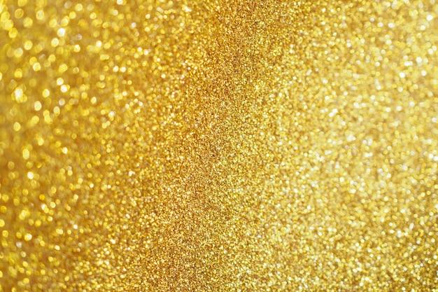 Abstracte gouden glitter fonkelingsachtergrond