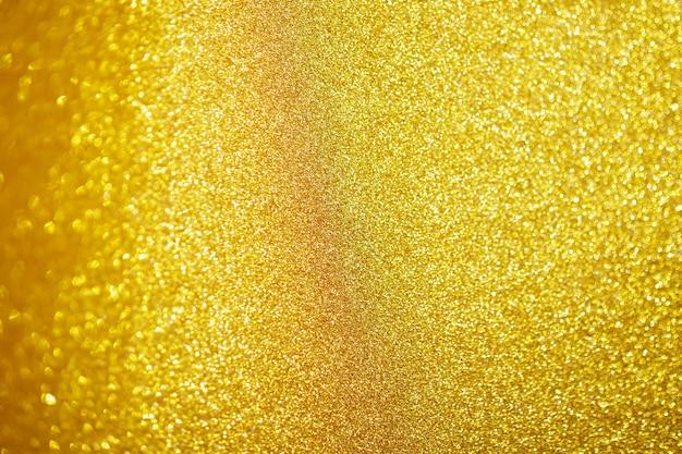Abstracte gouden glitter schittering met bokeh lichte achtergrond