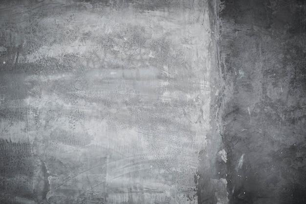 Abstracte grijze verf met borstel en cement de achtergrond van de muurtextuur