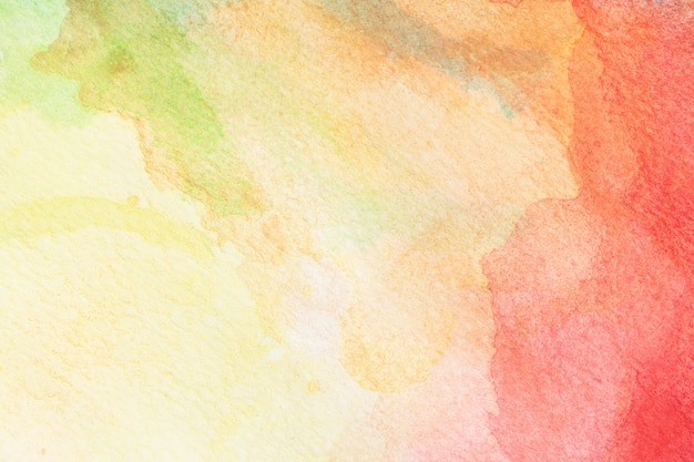 Abstracte groene, gele, oranje en rode roos aquarel achtergrond. kunst hand verf