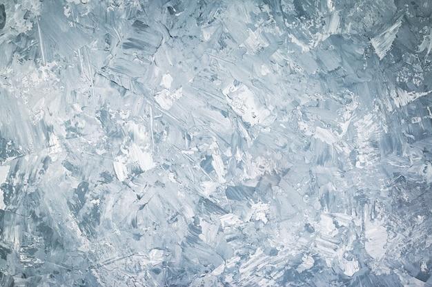 Abstracte grunge decoratieve blauwe of grijze gepleisterde muur