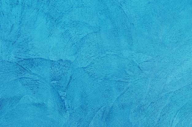 Abstracte grunge decoratieve ruwe ongelijke marineblauw gipspleistermuur achtergrond