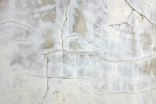 Abstracte grunge en barstcement muurachtergrond.