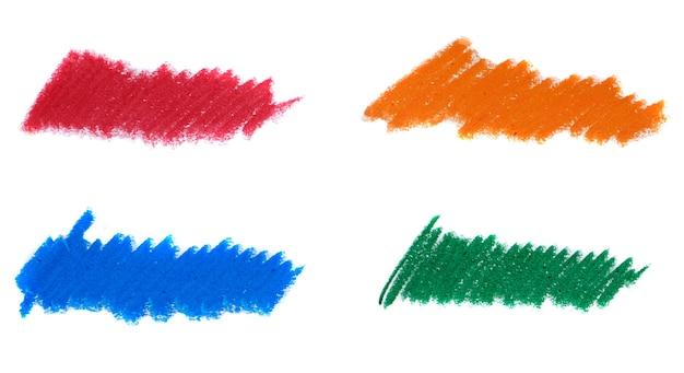 Abstracte kleurpotlood op witte achtergrond. de blauwe, oranje, groene en rode textuur van het krijtkrabbel. was pastel vlek.