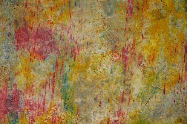 Abstracte kleurrijke grungeachtergrond met gele, groene toon en rood als bloedplons