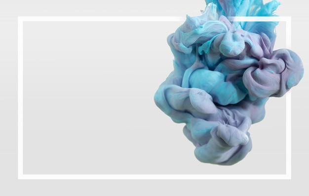 Abstracte kleurrijke inktdaling op duidelijke achtergrond met frame.