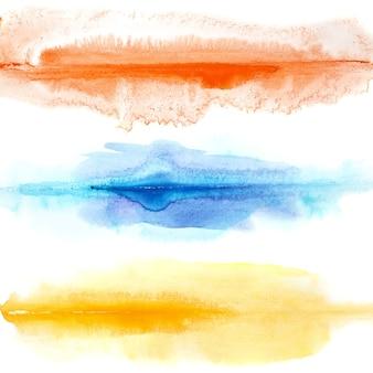 Abstracte kleurrijke waterverflijnen die over de witte achtergrond worden geïsoleerd