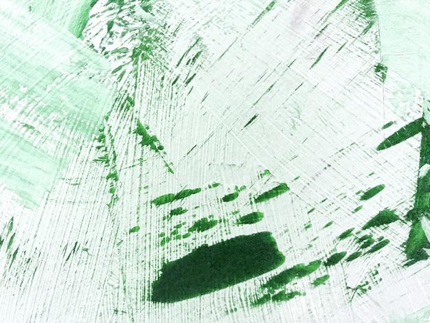 Abstracte kunst achtergrond donker groene en witte kleuren. aquarel schilderij op canvas met smaragd kleurverloop.