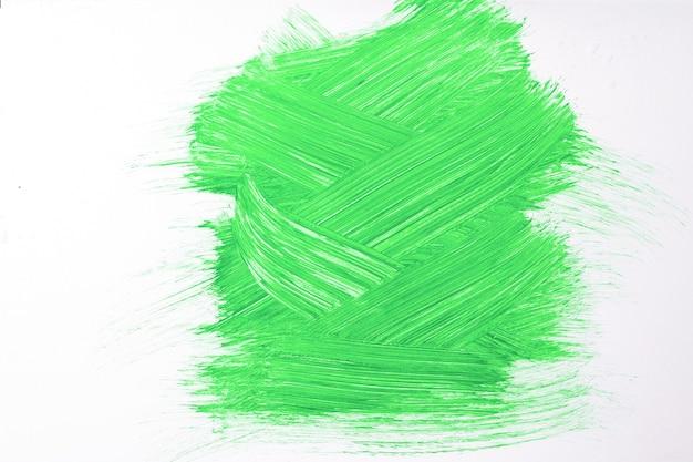 Abstracte kunst achtergrond helder groene en witte kleuren. waterverfschilderij op canvas met olijfstreken en plons. acryl kunstwerk op papier met voorbeeld. textuur achtergrond.