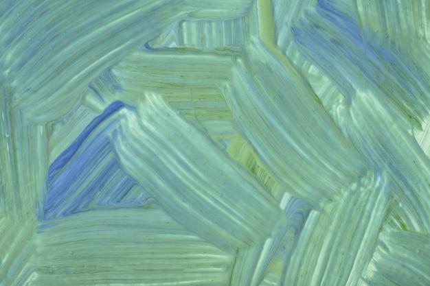 Abstracte kunst achtergrond licht groene en blauwe kleuren. aquarel op doek met cyaan slagen en plons. acryl kunstwerk op papier met penseelstreekpatroon. textuur achtergrond.