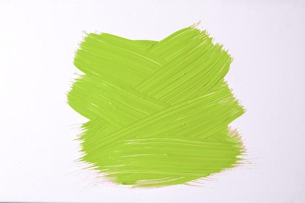 Abstracte kunst achtergrond licht groene en witte kleuren. aquarel op doek met olijfstreken en plons. acryl kunstwerk op papier met voorbeeld. textuur achtergrond.