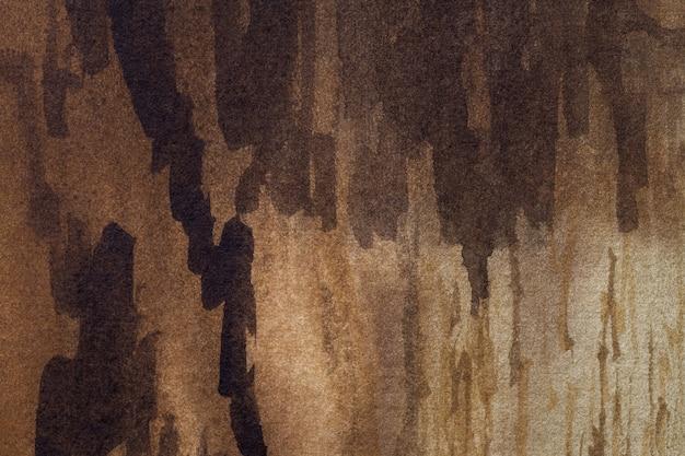 Abstracte kunst donkerbruine en beige kleuren.