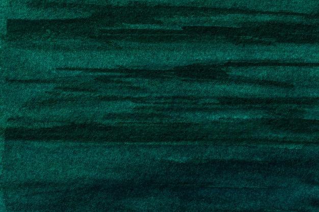 Abstracte kunst donkergroene en zwarte kleuren als achtergrond. aquarel op canvas met zacht smaragdgroen verloop. fragment van illustraties op papier met cyaanpatroon. textuur achtergrond.