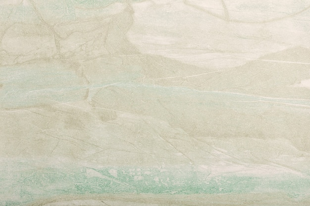 Abstracte kunst licht beige en groene kleuren als achtergrond. aquarel op canvas met zacht olijfgroen verloop.