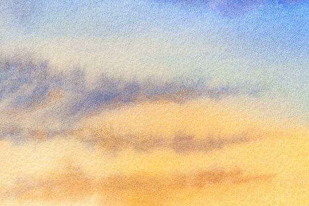 Abstracte kunst lichtblauwe en gele kleuren als achtergrond. aquarel schilderij op canvas met vlekken.