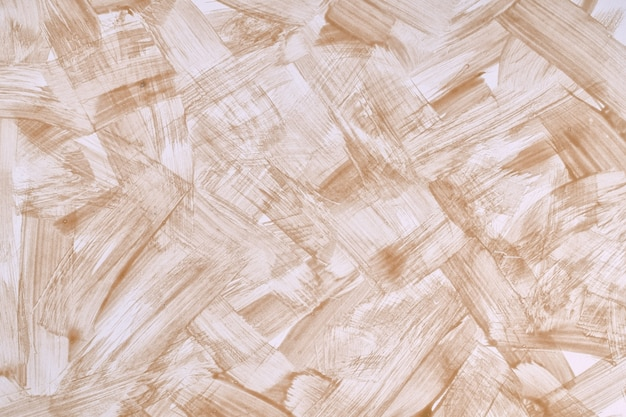Abstracte kunst lichtbruine en witte kleuren als achtergrond. aquarel op canvas met slagen en plons