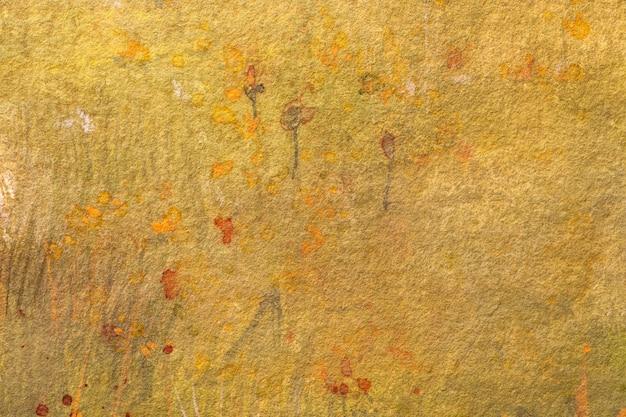 Abstracte kunst lichtgele en oranje kleuren als achtergrond. aquarel op doek met rode vlekken en verloop.