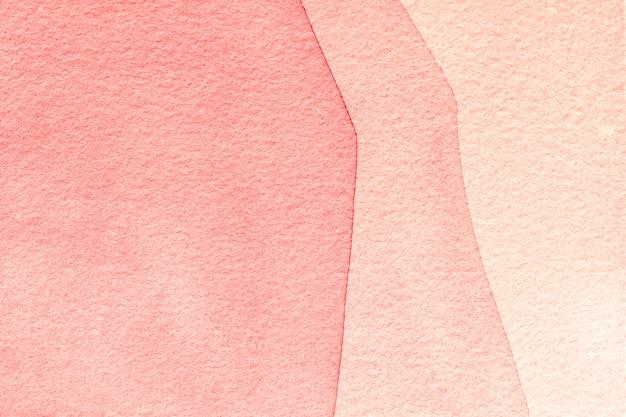 Abstracte kunst lichtrose als achtergrond en koraalkleuren. aquarel op doek met verloop.