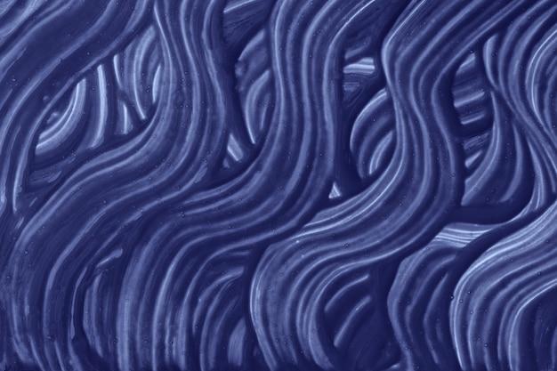 Abstracte kunst marineblauwe kleuren als achtergrond. aquarel op canvas met indigo krullende streken en spetters