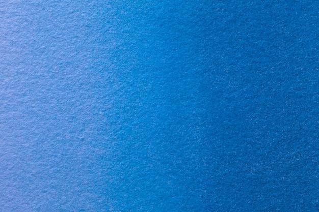 Abstracte kunst marineblauwe kleuren als achtergrond. aquarel op canvas met zacht denim verloop.