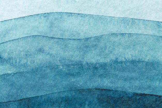 Abstracte kunst marineblauwe kleuren als achtergrond. aquarel op doek met turquoise patroon van golven van de zee.