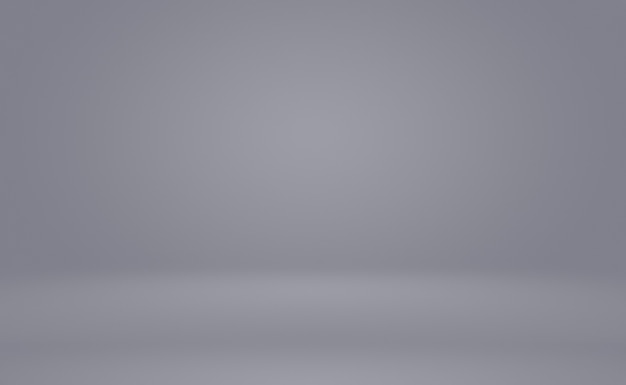 Abstracte luxe vervagen donkergrijs en zwart verloop, gebruikt als achtergrondstudiomuur voor het weergeven van uw producten. effen studio achtergrond.