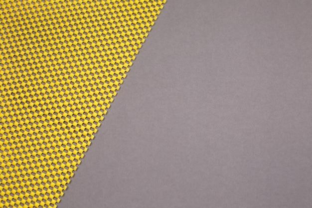 Abstracte moderne gele en grijze achtergrond. demonstrerende kleuren van het jaar 2021. bovenaanzicht.