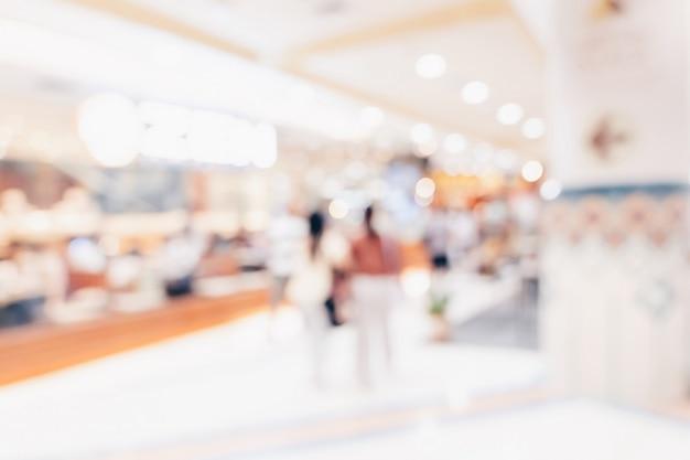 Abstracte onduidelijk beeld achtergrondmenigtemensen in winkelcomplex