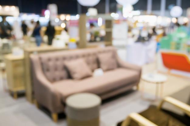 Abstracte onscherpte sofa in interieur meubelen showroom winkel interieur met bokeh lichte achtergrond voor montage product display