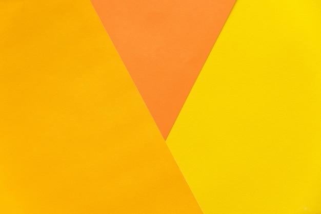 Abstracte oranje en gele papieren stapelen zich samen in abstracte vorm. abstracte kleur papier achtergrond.