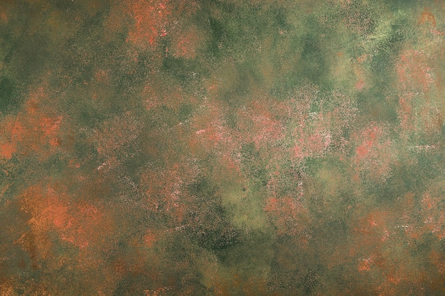 Abstracte oranje-groene achtergrond met witte krassen in grungestijl. concept voor uw ontwerp.