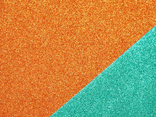 Abstracte oranje-turquoise glter achtergrond.