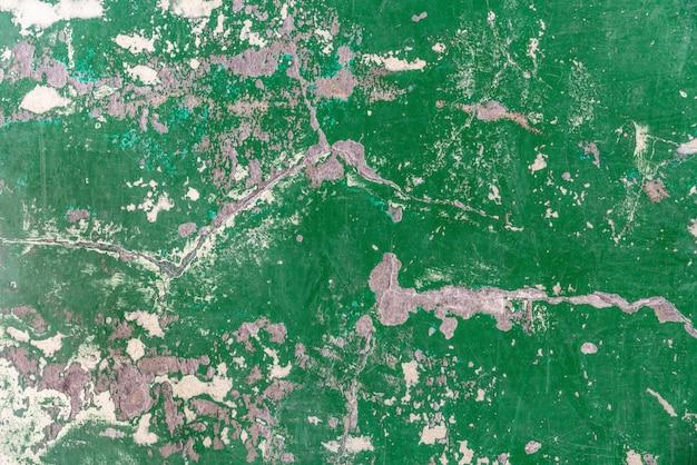 Abstracte oude en verlaten groene de vloertextuur van de barst epoxy.
