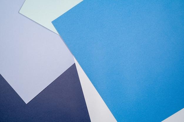 Abstracte paper achtergrond met blauwe en cerulean kleuren.