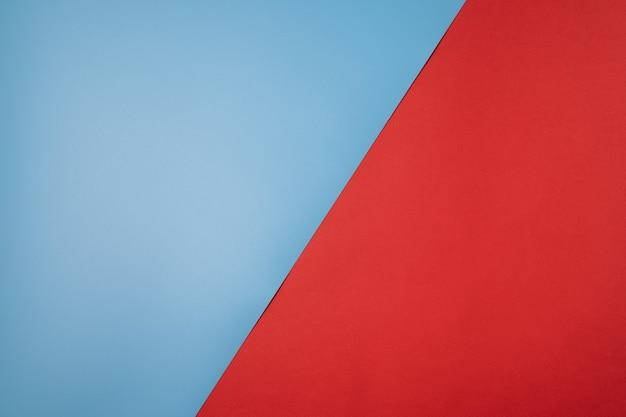 Abstracte papier achtergrond met rode en blauwe kleuren, met geometrische vorm.