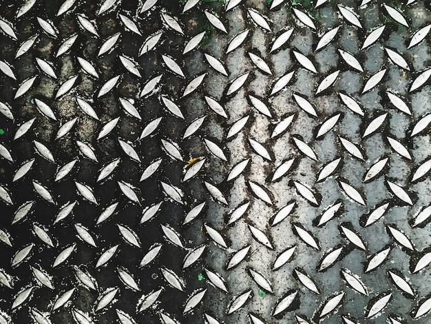 Abstracte patroon achtergrondstaalvloer in industriële fabriek