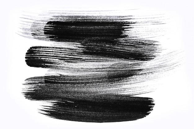 Abstracte penseelstreken en verfspatten op papier