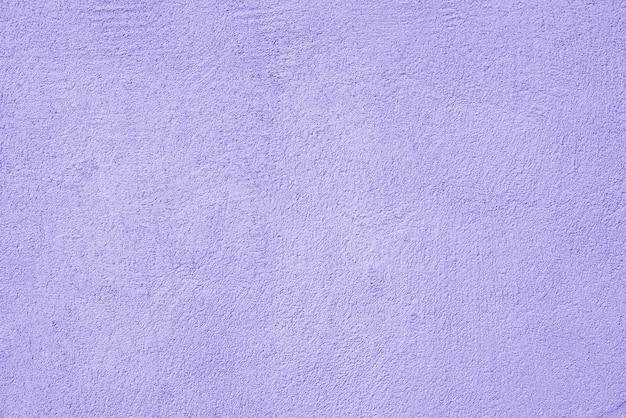 Abstracte ruwe violette textuur gepleisterde bouwmuur