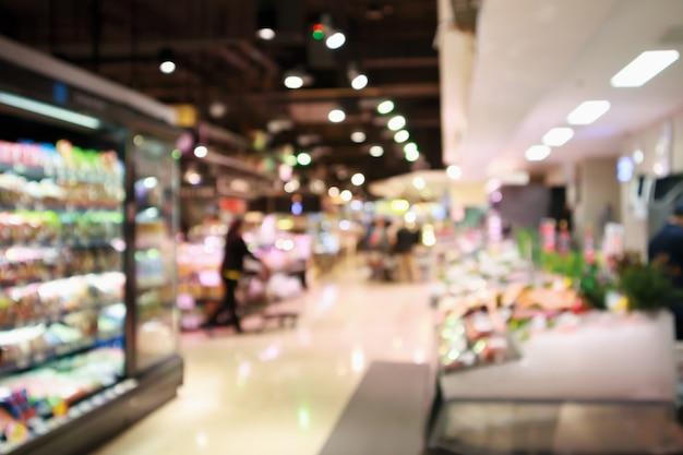 Abstracte supermarkt-supermarkt wazig intreepupil achtergrond met bokeh licht