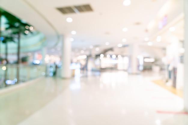 Abstracte vervaging winkel en winkel in winkelcentrum